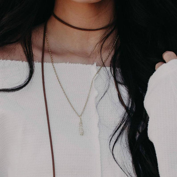 Clear Quartz Hand Wrapped Crystal Necklace, on a brunette models neck | Handmade Intention Jewelry