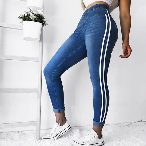 Women's blue jeans with white stripes. Plus size women's blue jeans