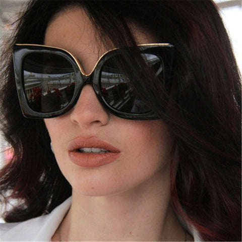Large, sophisticated square style women's sunglasses. Black frame