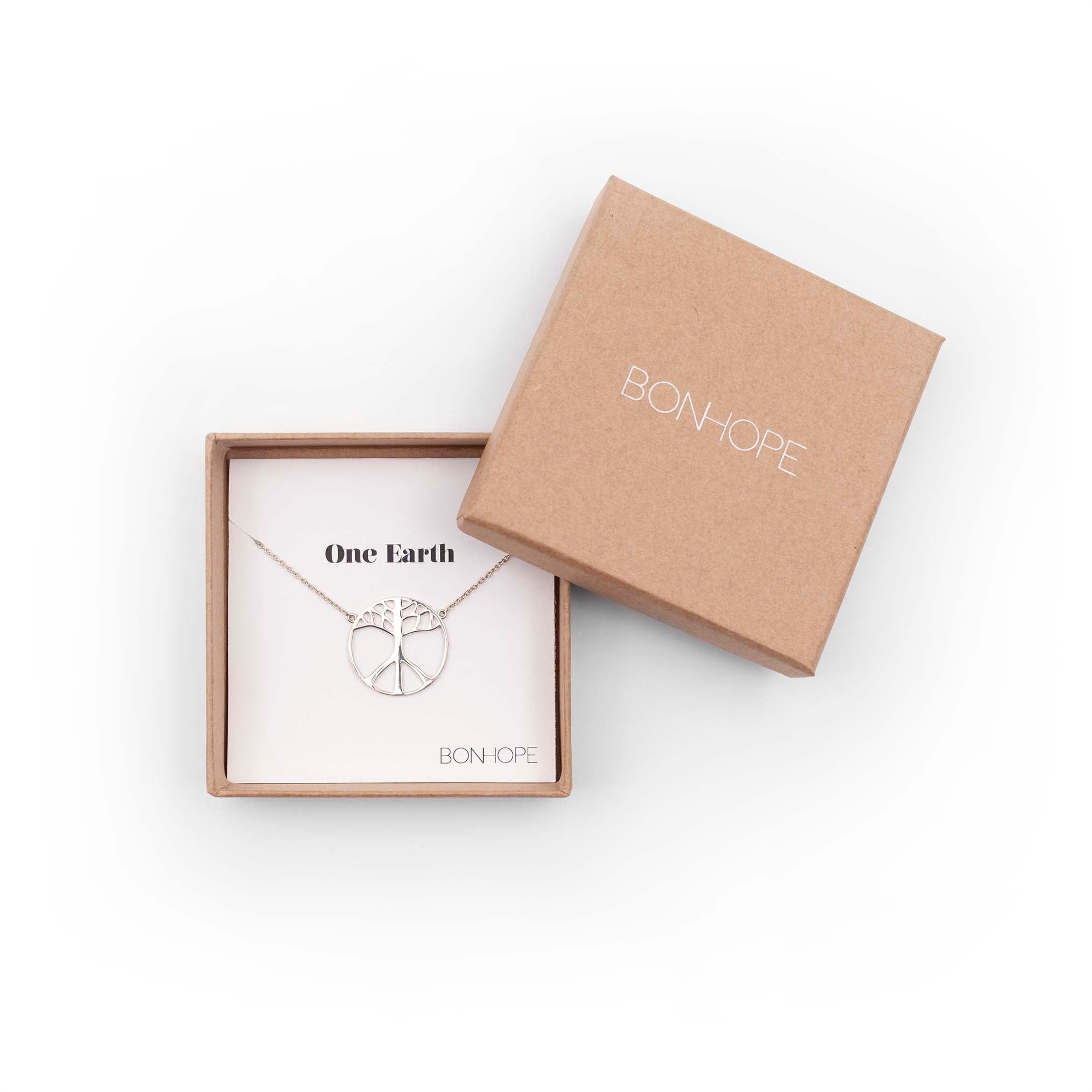 BON HOPE -One Earth Silver Necklace. The symbol is a merge of the tree of life and the classic peace symbol. 100% recycled silver jewelry ethically made in Bali.