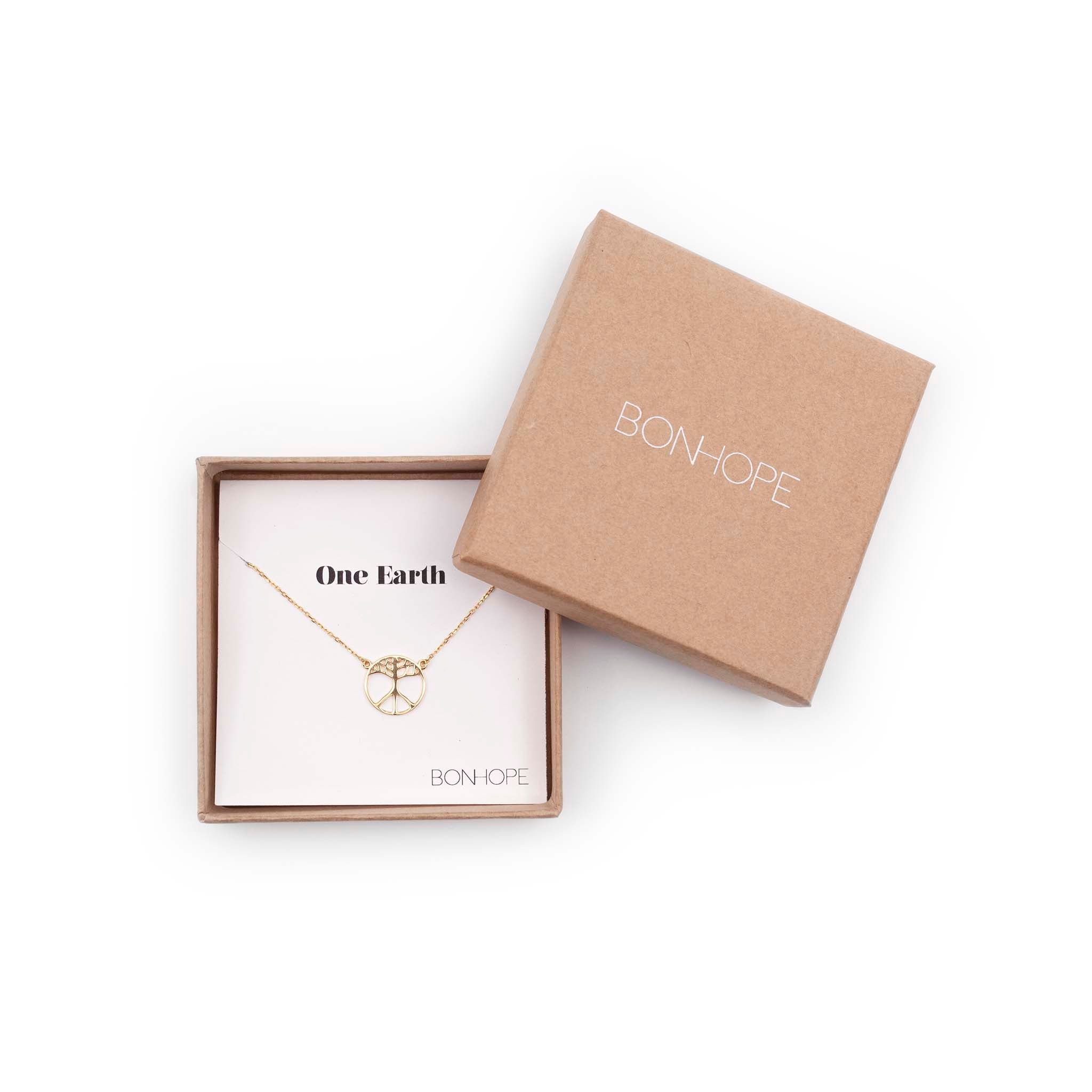 BON HOPE -One Earth Gold Necklace. The symbol is a merge of the tree of life and the classic peace symbol. 100% recycled silver jewelry ethically made in Bali.