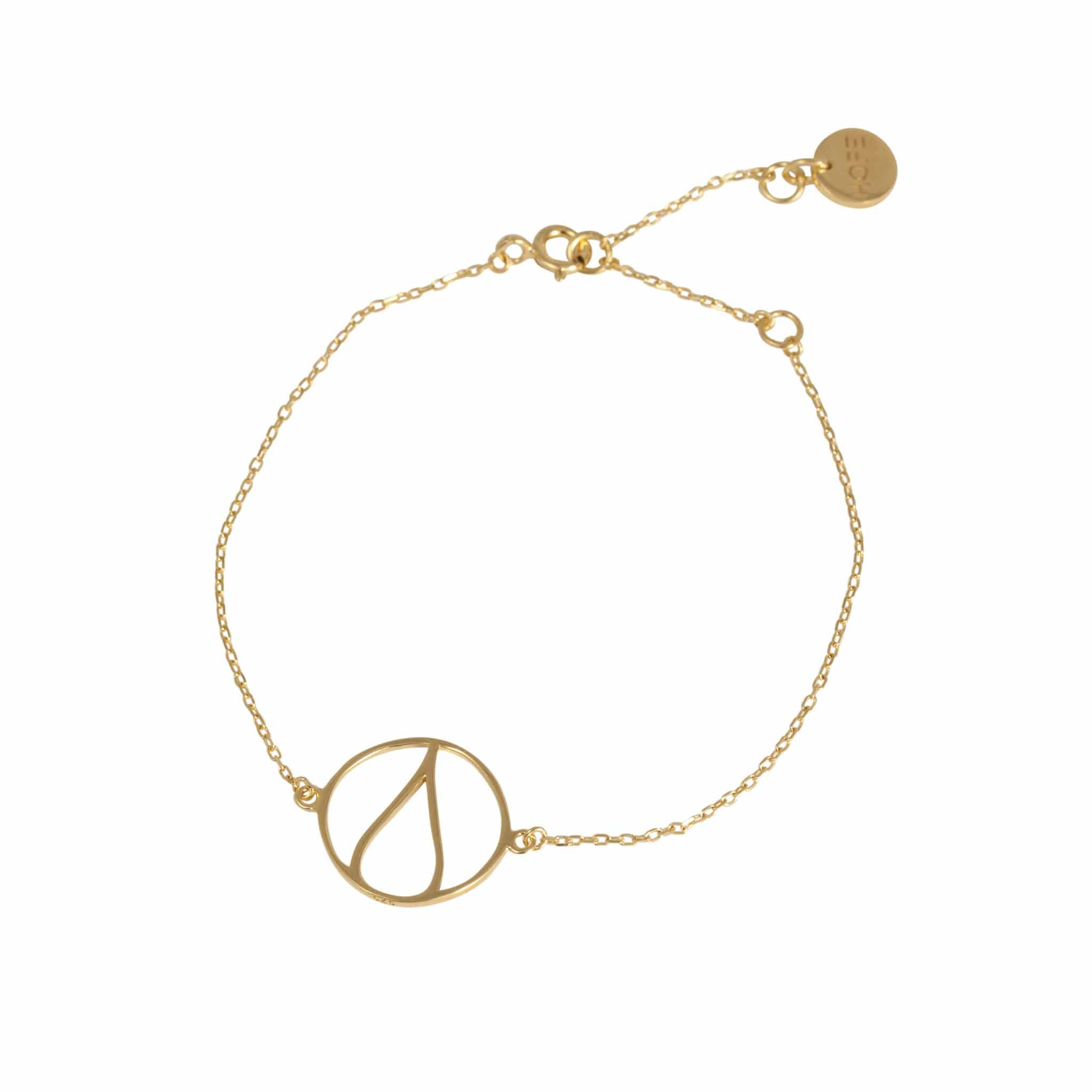 One Ocean Gold Bracelet. The symbol is a water drop in a circle that symbolizes our earth. 100% recycled silver jewelry ethically made in Bali.