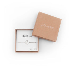 One Ocean Silver Bracelet. The symbol is a water drop in a circle that symbolizes our earth. 100% recycled silver jewelry ethically made in Bali.