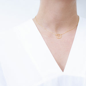 One Ocean Gold Necklace. The symbol is a water drop in a circle that symbolizes our earth. 100% recycled silver jewelry ethically made in Bali.