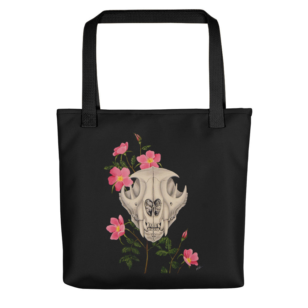Mountain lion skull with pink wild roses art print on a weather resistant spun polyester tote bag by Naked Grit