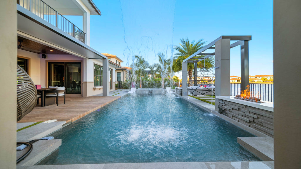 A Poolside Haven, Tucked Away In The Backyard Of This South Florida Residence