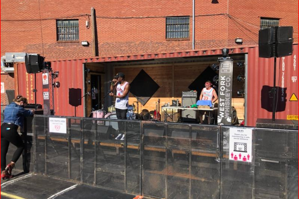 Shipping Container being used as a stage for a singer