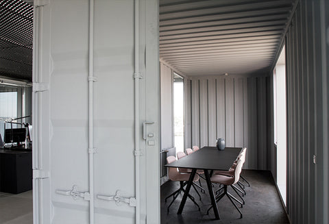 Interior view of the shipping container office conference room.