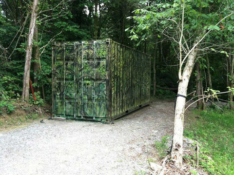 Shipping Container camouflaged in the woods