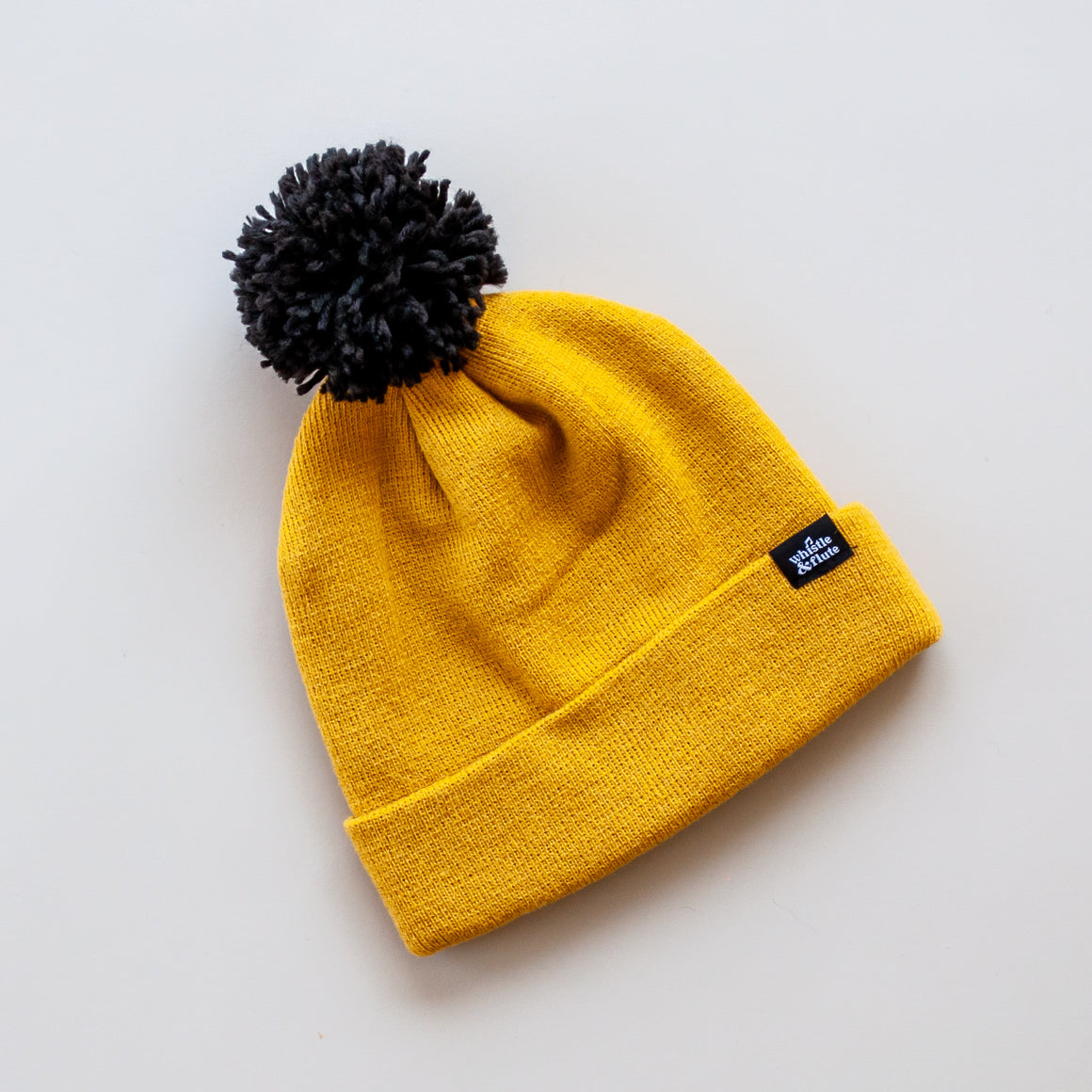 Whistle and Flute Knit Hat