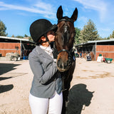 LV sharing a victory kiss with her competition horse, Frankie.