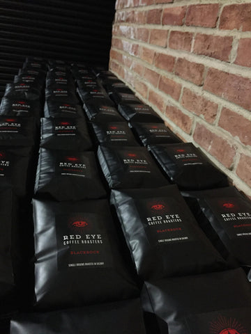 picture of coffee bags stacked on a pallet