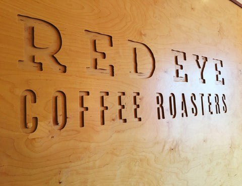 picture of the Red Eye coffee roaster log carved in wood