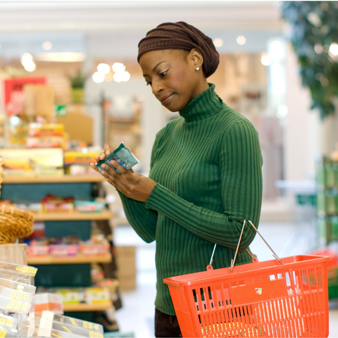 woman looking at food label