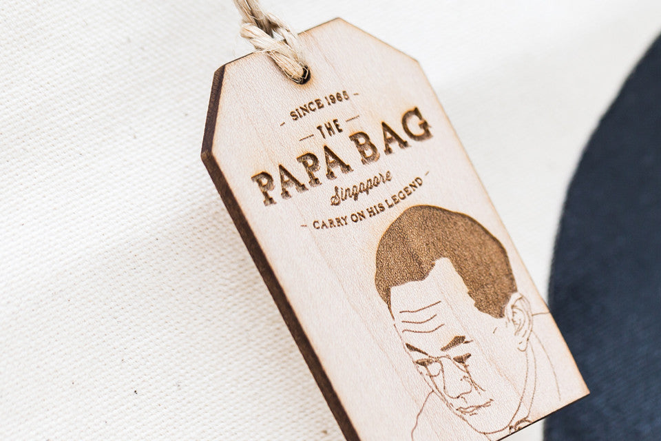 Each bag is paired with a thick wooden tag engraved with a specific quote from Minister Mentor Lee Kuan Yew reflective of his portrait drawn.