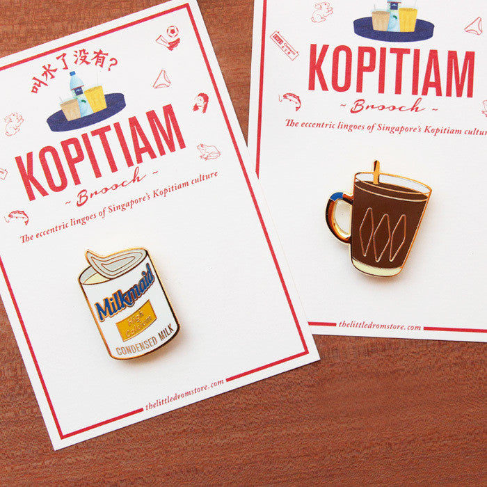 The familiar Milkmaid Condensed Milk brooch shown here pays tribute to our alternative to milk for coffee (that's Kopi for you), and our unhealthy, yet oh-so-delicious replacement for butter to bread.