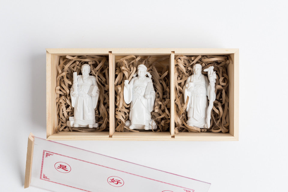 Each set comes in a wooden box