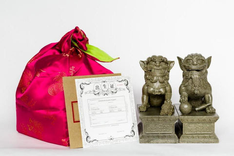 The GOODSTUPH Stone Lions snuggle up in a cost oriental wrap and a birth certificate for the rightful owner.
