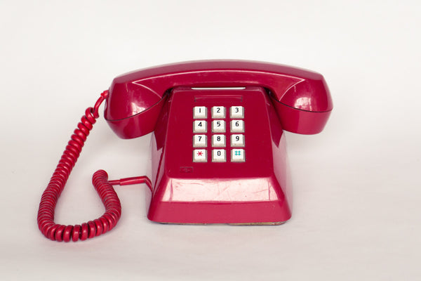 1980s retro telephone in red.
