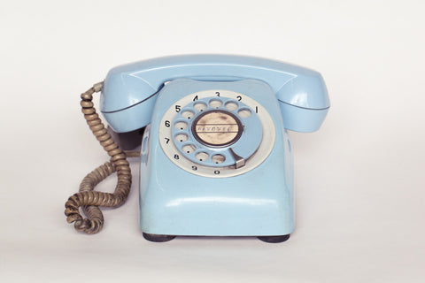 1980s retro telephone in baby blue.