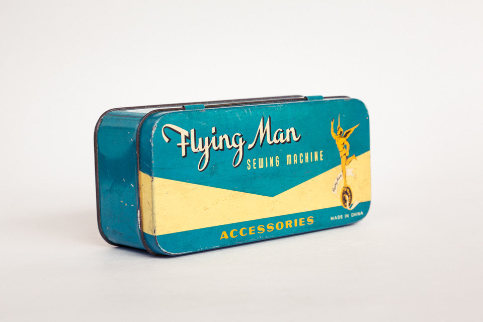 Flying Man Sewing Tin.