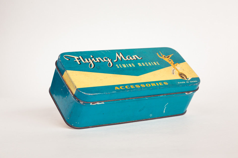 Flying Man Sewing Tin