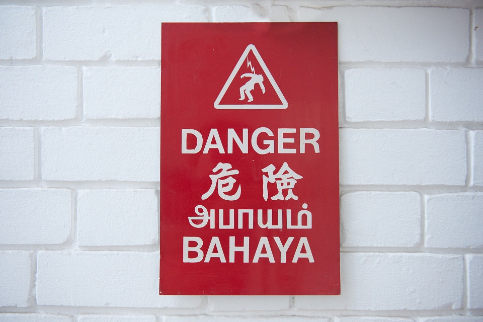50 year-old red danger sign