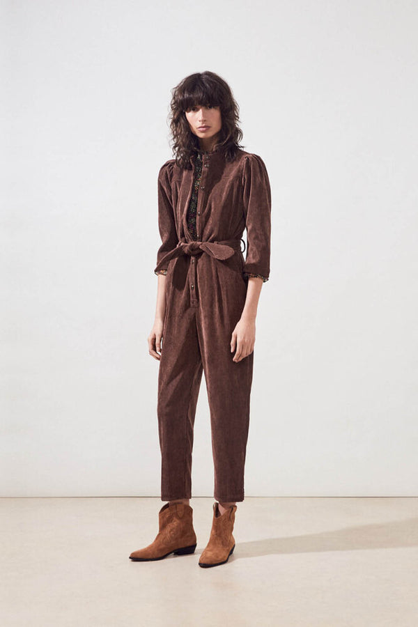 Front of jumpsuit on model.