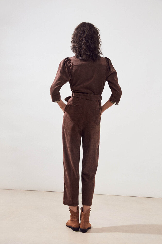Back of jumpsuit on model.