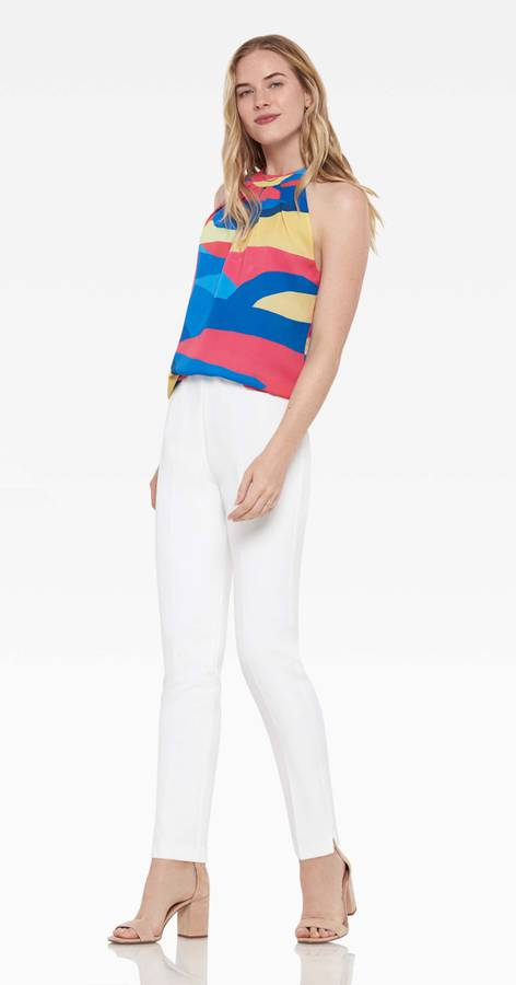 Front of pants on model wearing a colorful tank and heels.