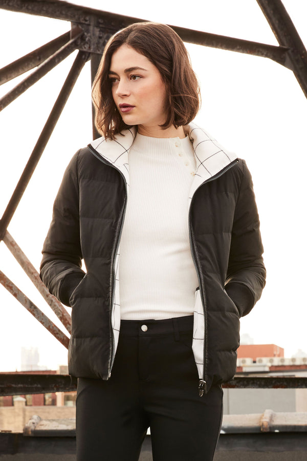 Model wearing jacket with black side out.