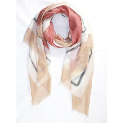 A half rolled flat of the Ama Pure Three Frames scarf in the color rose.
