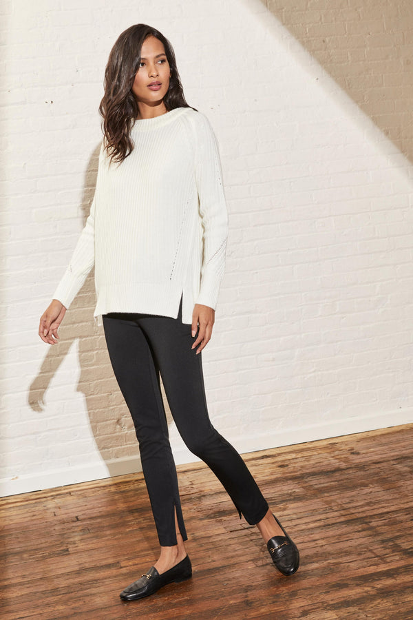 Front of leggings paired with a sweater on model.