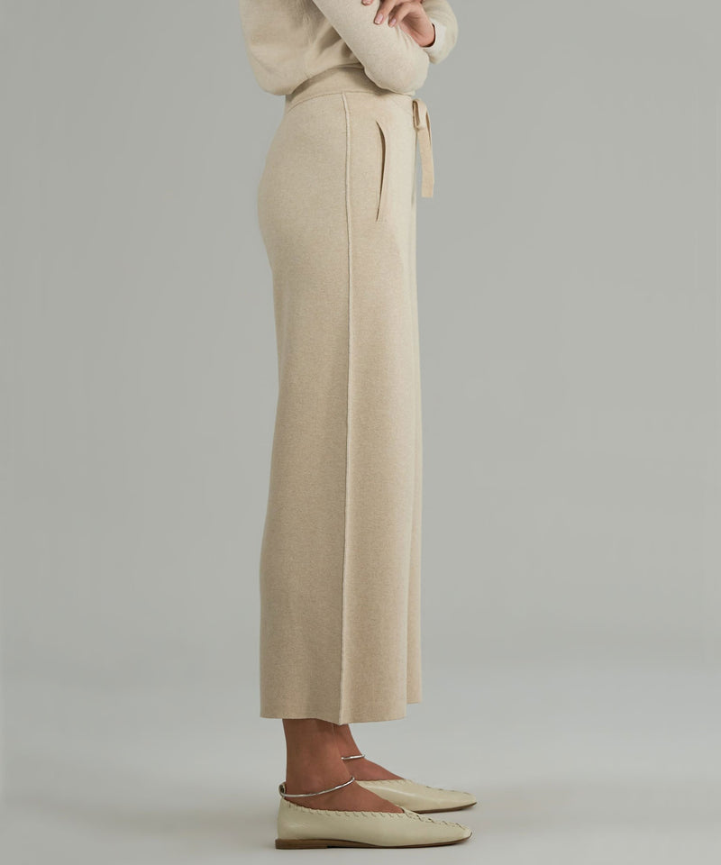 The side view of the sweater pant from ATM. This pant has a wide leg thats cropped, and an elegant side seam detail.