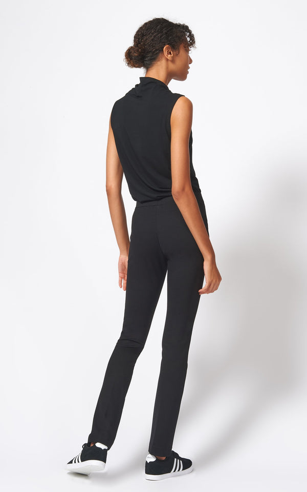 A back view of the ponte straight leg pant in black.