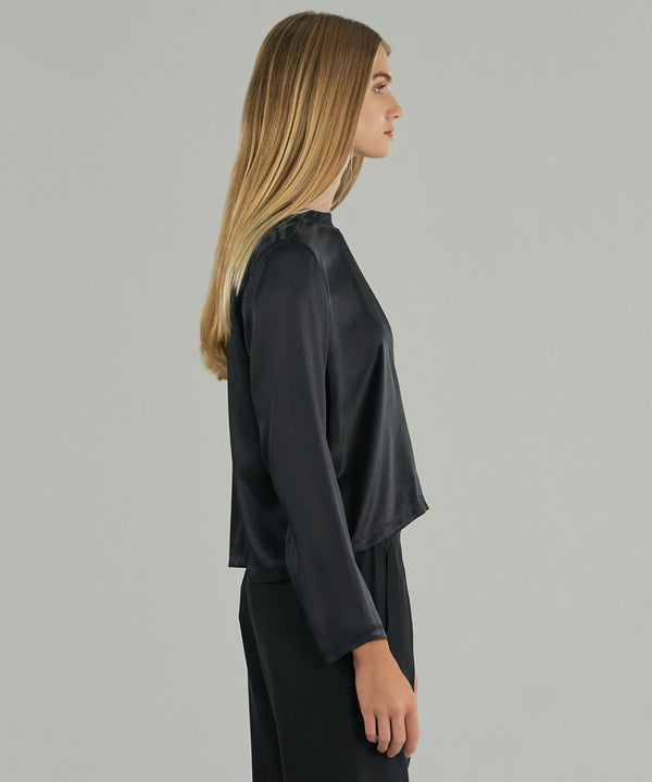 A side view of the silk long sleeve from ATM. This tee is slightly cropped and has a long, wide sleeve.