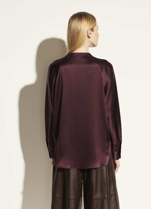 The back view of the band collar blouse. This blouse has a classic shirt tail finish.