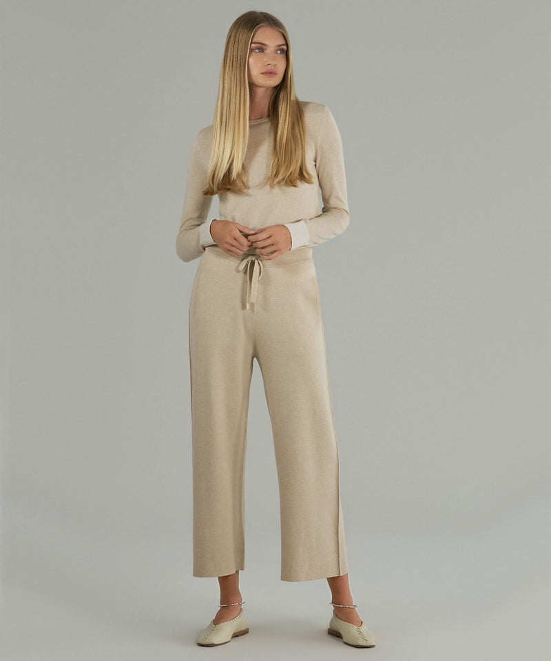 A full view of the sweater pants on a model. These pants have a matching cotton cashmere top for a full loungewear look.