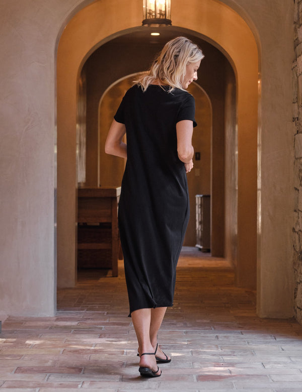 The back view of the essential tee dress in black from Tee Lab.