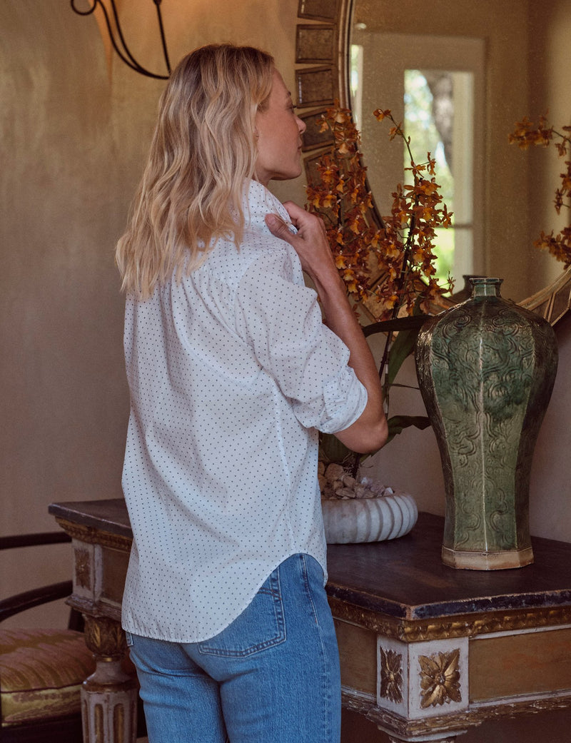 A back view of the Frank button down shirt in Navy Faded dot by Frank & Eileen. The model is seen here adjusting the collar. Also featured is the tail of the shirt.
