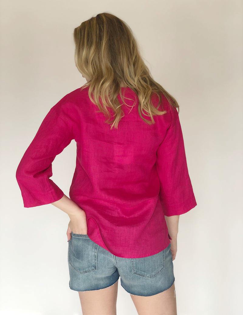 Back of top on model with hand in back pocket.
