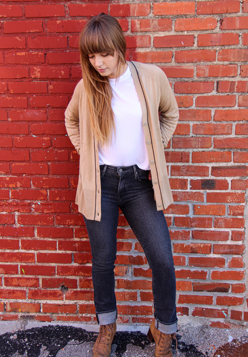 Front of jeans on model with top and cardigan.