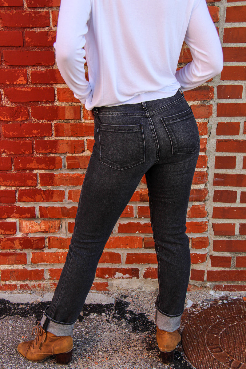 Back of jeans on model, cropped for a closer look at jeans.