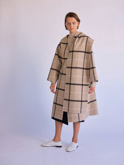 Front of coat with scarf on model.