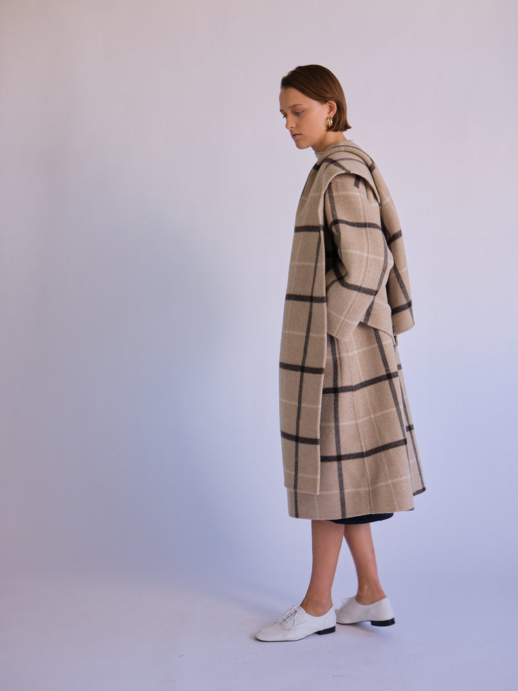 Side of coat with scarf on model.