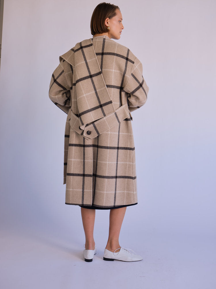 Back of coat with scarf on model.