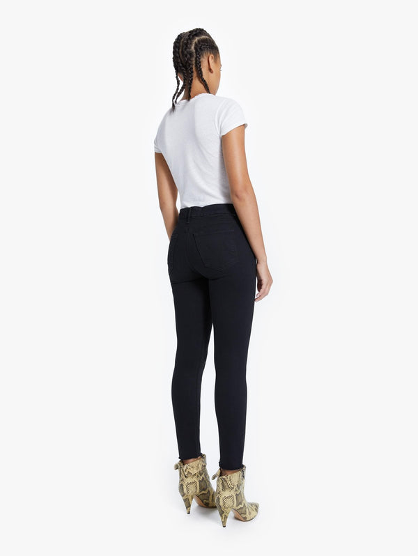 A back view of the Mother Ankle Fray looker jean in the color Not Guilty.