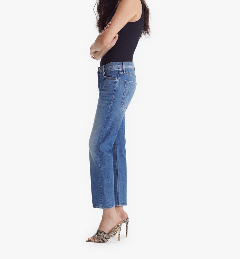 Side of jeans on model with her arms crossed, wearing a black tank and heels.