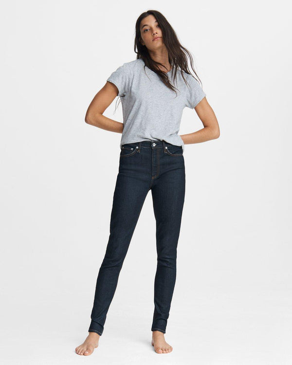 A front view of the Nina Skinny jean in Indigo Rinse. The model is wearing this denim with a basic light grey tee.