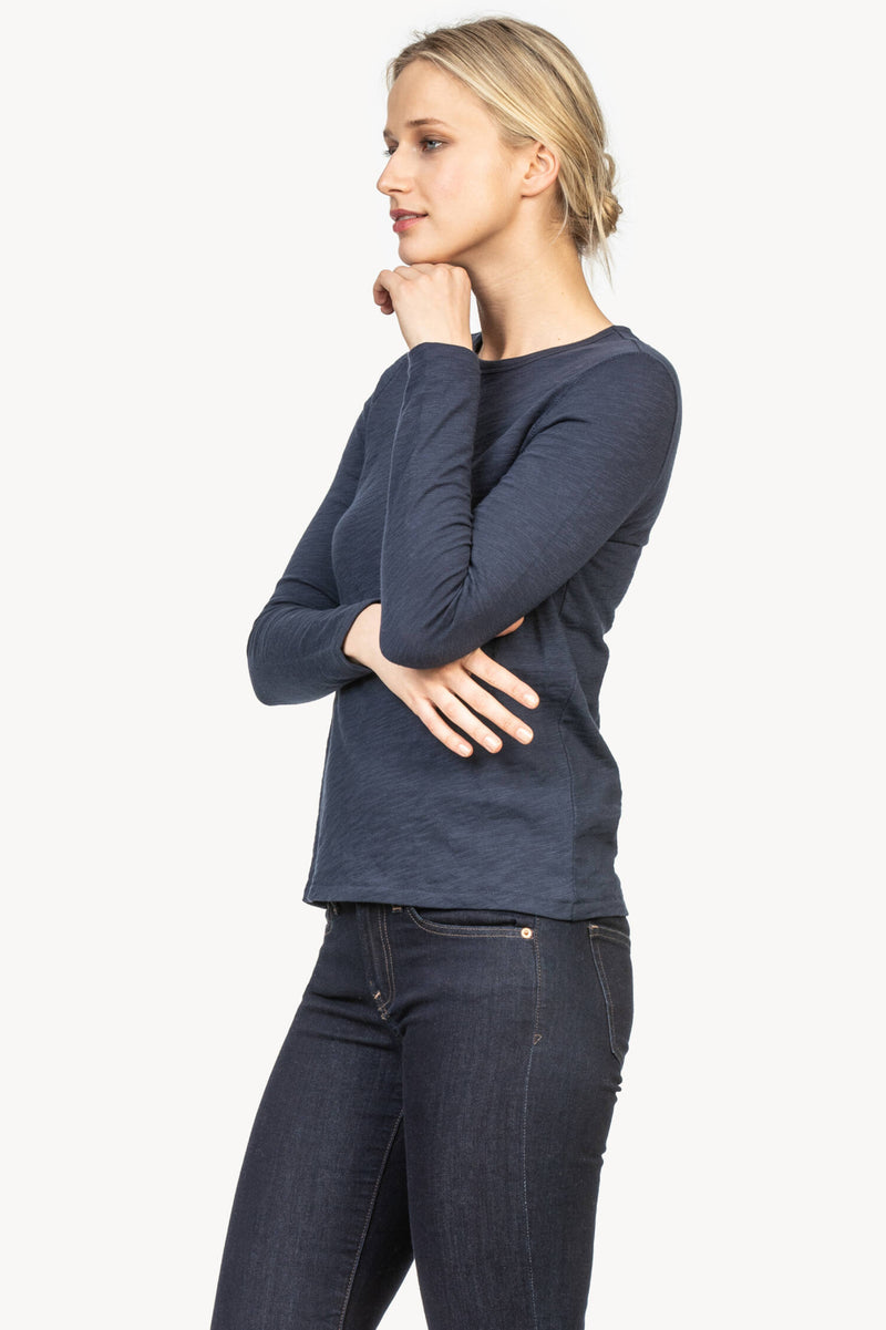 A side view of the Lilla P. long sleeve crew neck tee in the color midnight.